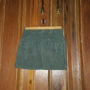 Olive corduroy mini cargo skirt.